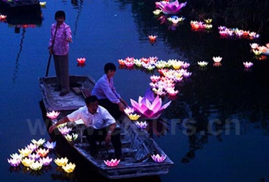 The lanterns are usually made of paper, in the shape of a lotus flower, with a light or candle at the bottom.