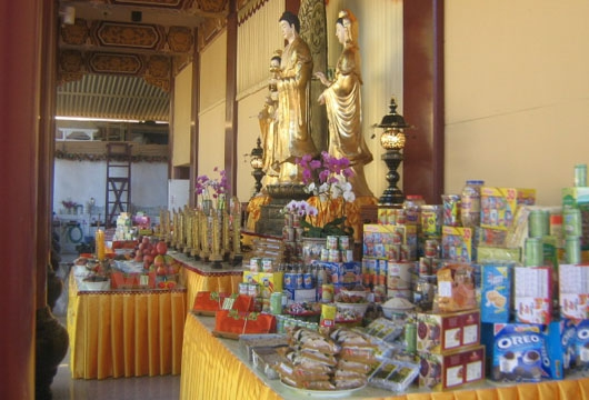 An array of foods being offered to the deceased at a Buddhist temple, which is often prepared to feed the hungry ghosts.